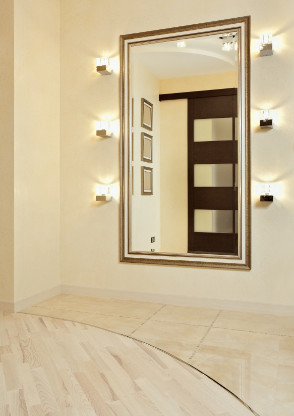Mirror in golden frame in beige colored anteroom