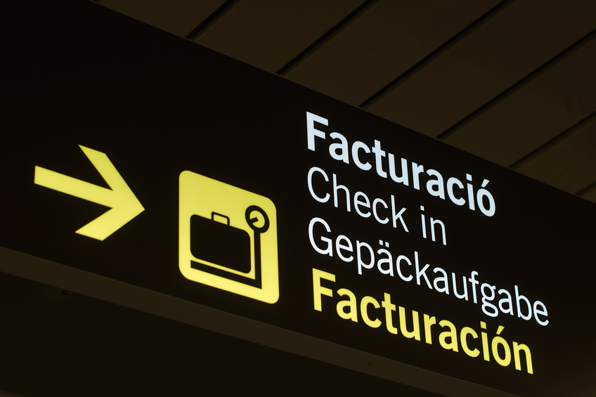 neon sign check-in at the airport of Palma de Mallorca, Spain